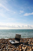 Laptop on beach — Stock Photo