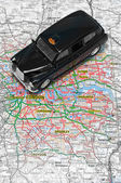 London taxi cab on map of london — Stock Photo