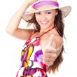 Portrait of an attractive girl shows thumbs-up — Stock Photo