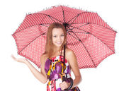 Cheerful girl under umbrella — Stock Photo