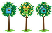 Birdhouses on trees — Stock Vector