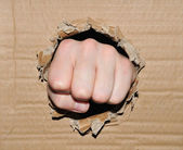 Fist breaking through — Stock Photo