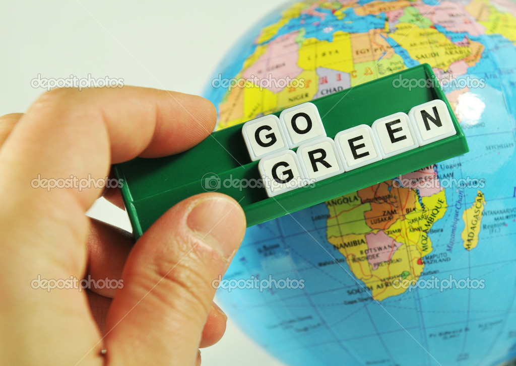 Go green concept with key words and Earth globe in the background — Stock Photo #6559533