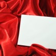 Blank card on red silk — Stock Photo #6588807