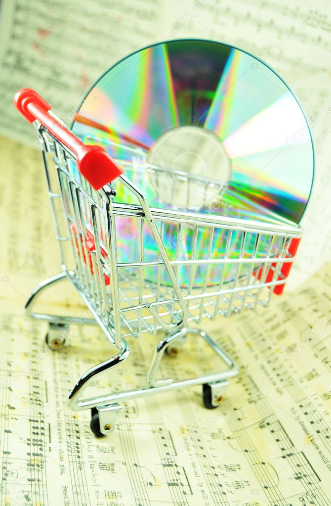 Music sheet and CD in a shopping cart — Stock Photo #6638698