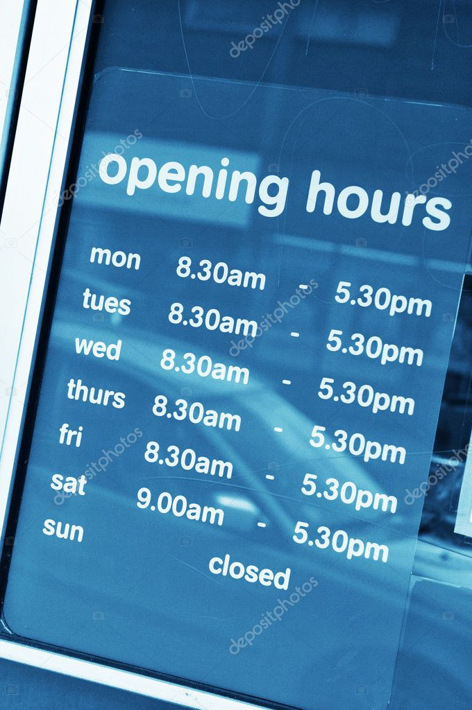 Business opening hours in shop window  Stock Photo #6639555
