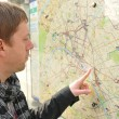 Tourist and map — Stock Photo