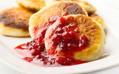 Pancakes with cranberry jam — Stock Photo