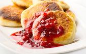 Pancakes with cranberry jam — Stock Photo