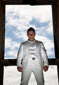 Man in white suit on sky — Stock Photo