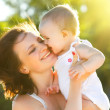 Happy mom and daughter smiling — Stock Photo