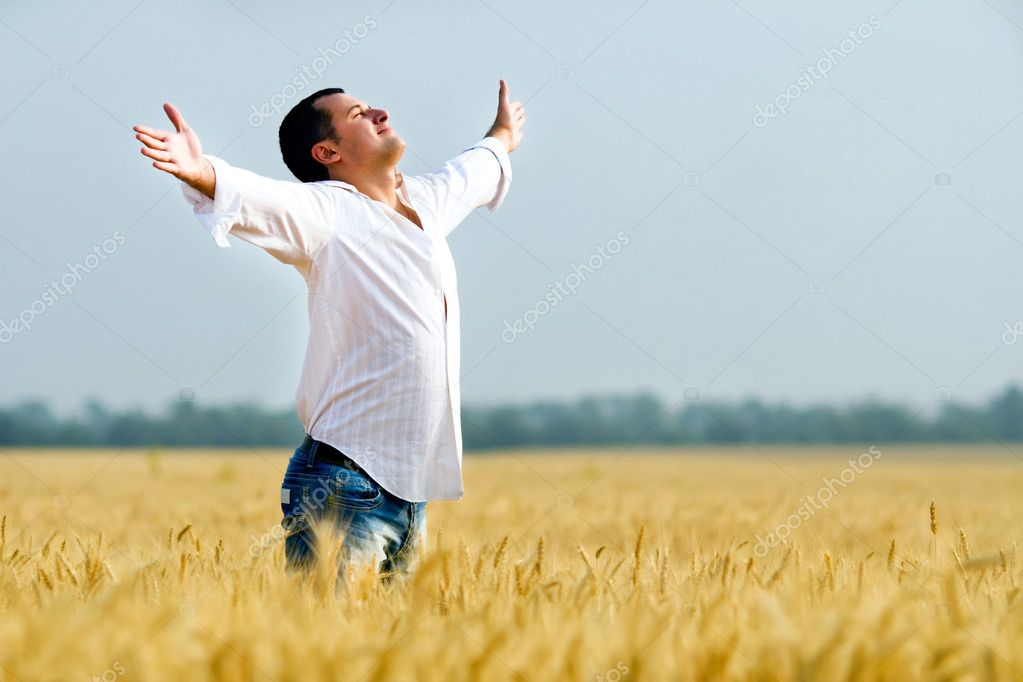 Happiness in golden summer corn field   Stock Photo #6028923