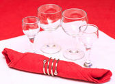 Four glasses and napkin — Stock Photo