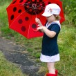 Little girl, umbrelland rubber boots — Foto de stock #6161359