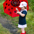Little girl, umbrelland rubber boots — Foto Stock #6161359
