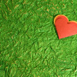 Red heart on Green — Stock Photo