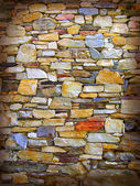 Coloured stone wall — Stock Photo