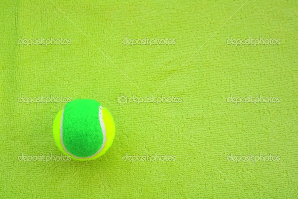 Green Tennis Ball on green — Stock Photo #6058048