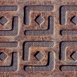 Metal plate with embossed of square designs — Stock Photo #6271513