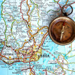 Brass compass in a Lisbon map — Stock Photo