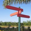 Plates of direction in red wood — Stock Photo