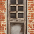 Royalty-Free Stock Photo: Window in an orange brick wall