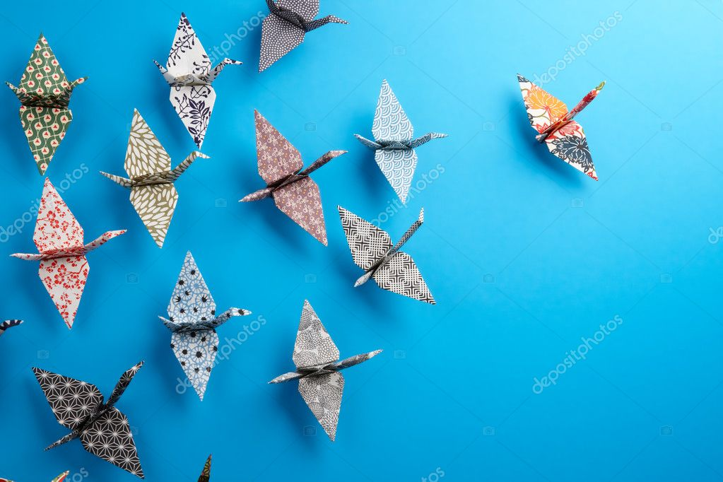 Colorful Origami birds flying to the light.  Stock Photo #5986614