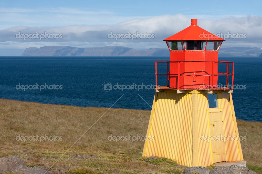 Small red Lighthouse at the end of Iceland at Akureyri's Fjord. — Stock Photo #6511120