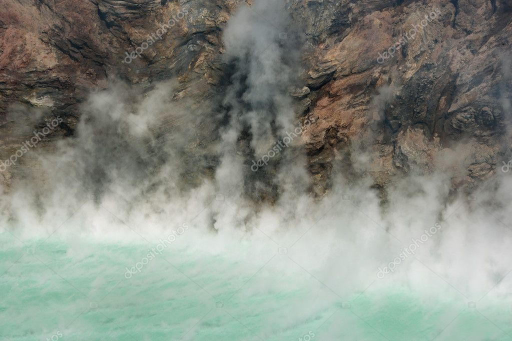 Volcano crater filled up with a phosphorical green steaming lake. — Stock Photo #6511161