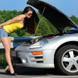 Stock Photo: Girl with a broken car