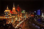 Shanghai Bund at Night China Flags Cars with Trademarks obscured — Stock Photo