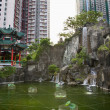 Stock Photo: Water Garden High Rise Buildings Wong Tai Sin Taoist Temple Kowl