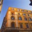 Bright Yellow Builidng Blue Skies Roman Streets Rome Italy - Stock Photo