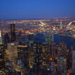 New York City Skyline East River Chrysler Building Night - Stock Photo