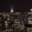 Stock Photo: New York City Skyline East River Empire State Building Night