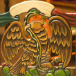 Stock Photo: Wooden Carved Chair Symbol of Mexico Eagle Holding Snake