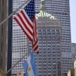 Stock Photo: Park Avenue Building Grand Central Terminal with Flags New York