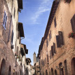 Narrow Street Via San Giovanni San Gimignano Tuscany Italy - Stock Photo