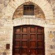 Ancient Brown Door Stone Doorway Medieval Town San Gimignano Tus - Stock Photo