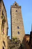 Medieval Stone Cuganensi Tower Flowers San Gimignano Tuscany Ita — Stock Photo