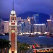 Hong Kong Clock Tower and Harbor at Night from Kowloon Ferry — Stock Photo