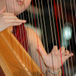 Playing the harp — Stock Photo