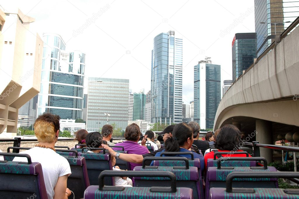 Traveling the city of hong kong on a convertible double decker bus — Stock Photo #6091456