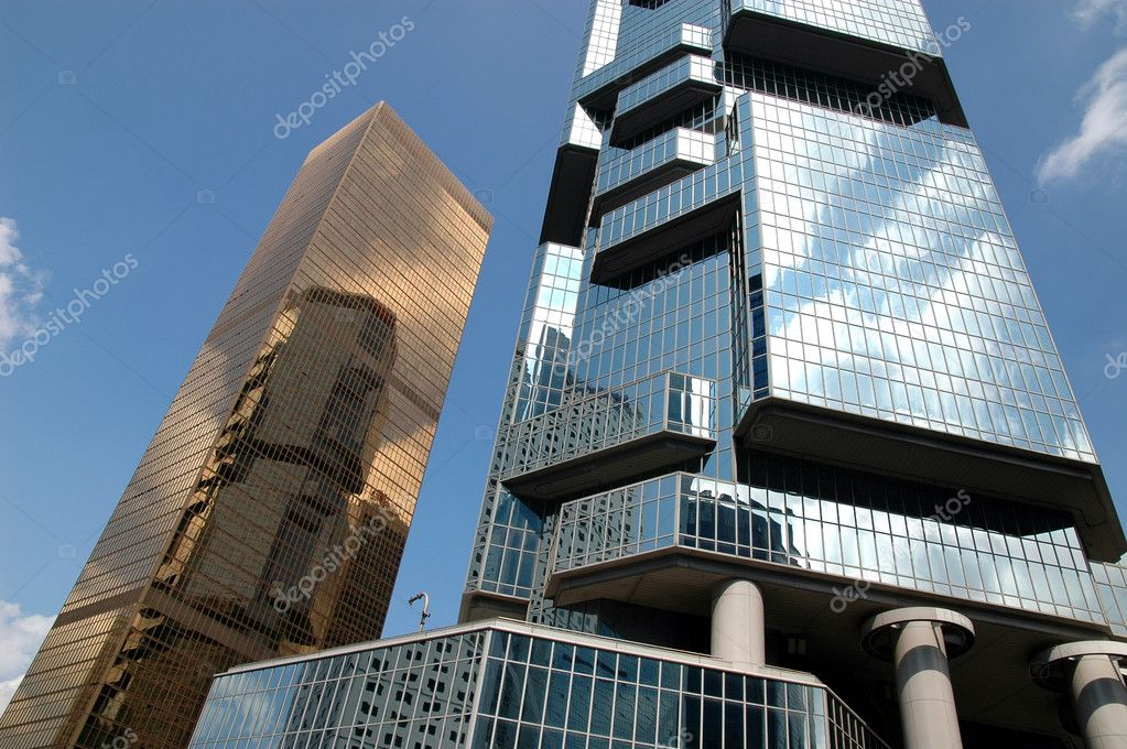 Golden business building, reflection building and blue sky — Stock Photo #6091537