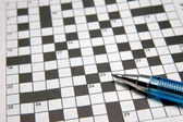 Crossword puzzle & pen — Stock Photo