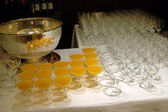 Table of glasses and cocktail — Stock Photo