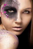 Portrait of a young woman with artistic make up — Stock Photo