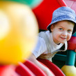 Young autistic boy playing on playground — Stock Photo