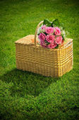 Wedding rose bouquet on a basket — Stock Photo
