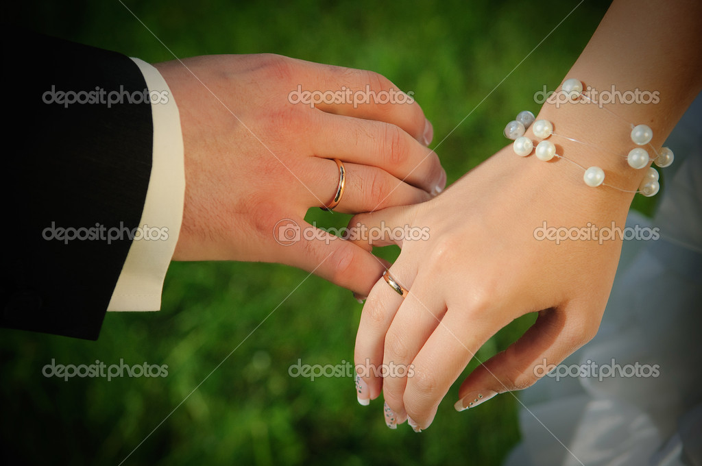 Couples hands with wedding rings — Stock Photo © kaznadey ...